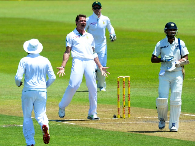 Dale Steyn of South Africa celebrates the wicket of Murali Vijay of India for 97 runs during day 2 of the 2nd Test match between South Africa and India at Sahara Stadium Kingsmead on December 27, 2013