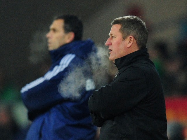 Cardiff City caretaker manager David Kerslake and Sunderland manager Gus Poyet look on during the Barclays Premier League match on December 28, 2013