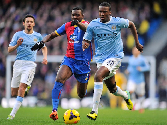Dedryck Boyata of Manchester City competes with Yannick Bolasie of Crystal Palace during the Barclays Premier League match on December 28, 2013