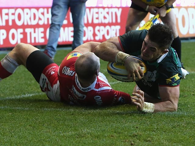 London Irish's Eamonn Sheridan dives over to score a try against Gloucester during their Aviva Premiership match on December 29, 2013