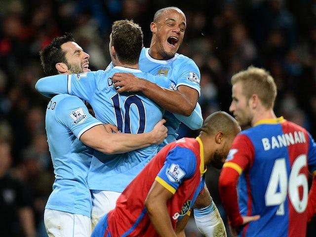 Manchester City's Bosnian striker Edin Dzeko celebrates with Alvaro Negredo and Vincent Kompany after a goal against Crystal Palace on December 28, 2013