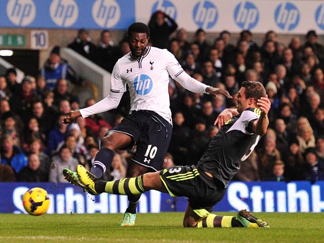 Spurs' Emmanuel Adebayor and Stoke's Erik Pieters in action during their Premier League match on December 29, 2013