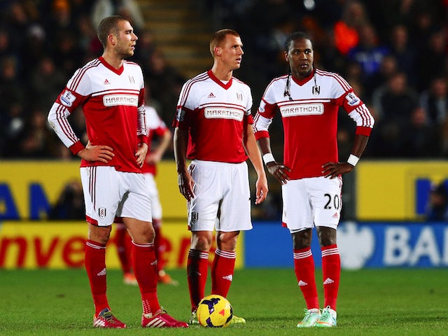 Pajtim Kasami, Steve Sidwell and Hugo Rodallega of Fulham prepare to restart the game after conceding a goal during the Barclays Premier League match on December 28, 2013