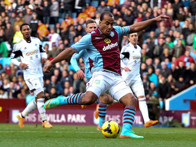 Gabby Agbonlahor of Aston Villa scores the opening goal of the game during the Barclays Premier League match against Swansea on December 28, 2013