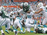 Geno Smith of the New York Jets dives for the end zone but is stopped short by the Miami Dolphins defense during second quarter action on December 29, 2013