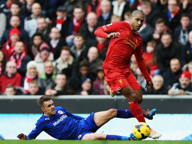 Glen Johnson of Liverpool is tackled by Craig Noone of Cardiff City during the Barclays Premier League match between Liverpool and Cardiff City at Anfield on December 21, 2013