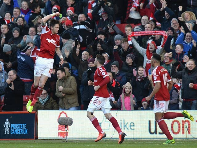 Forest's Greg Halford celebrates with teammates after scoring the opening goal against Leeds during their Championship match on December 29, 2013