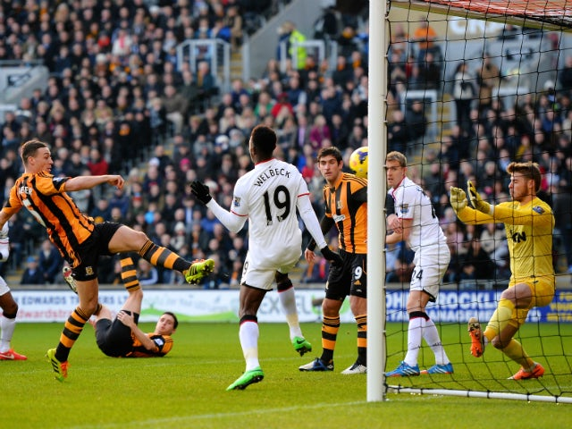 James Chester of Hull City scores the opening goal past David De Gea of Manchester United during the Barclays Premier League match between Hull City and Manchester United at KC Stadium on December 26, 2013