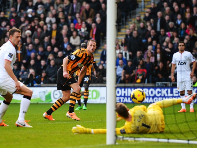 David Meyler of Hull City slots the ball past David De Gea the Manchester United goalkeeper to score his sides second goal during the Barclays Premier League match between Hull City and Manchester United at KC Stadium on December 26, 2013