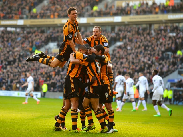 James Chester of Hull Cityis mobbed after scoring the opening goal during the Barclays Premier League match between Hull City and Manchester United at KC Stadium on December 26, 2013