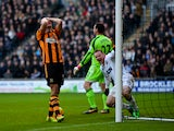James Chester of Hull scores an own goal in front of Wayne Rooney of Manchester United during the Barclays Premier League match between Hull City and Manchester United at KC Stadium on December 26, 2013