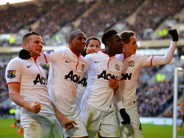 Tom Cleverley, Ashley Young, Danny Welbeck and Adnan Januzaj of Manchestere United celebrate the third goal during the Barclays Premier League match between Hull City and Manchester United at KC Stadium on December 26, 2013