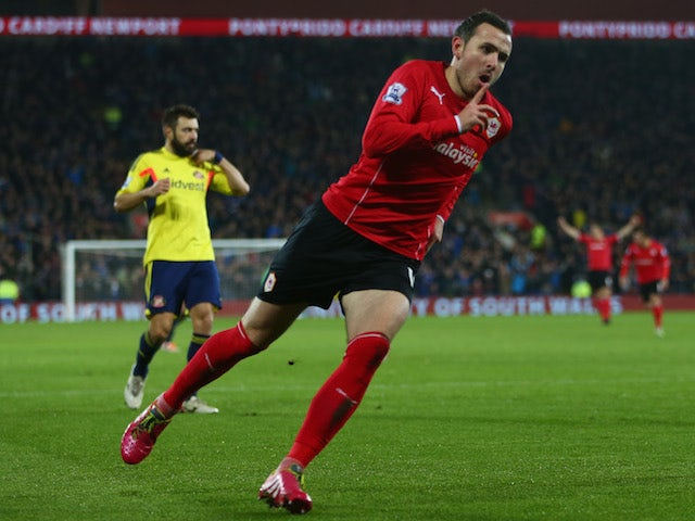 Jordon Mutch of Cardiff City celebrates scoring the opening goal during the Barclays Premier League match against Sunderland on December 28, 2013