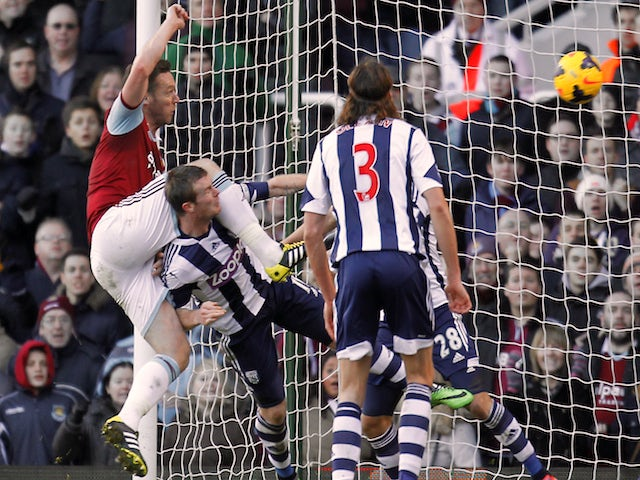 West Ham United's English midfielder Kevin Nolan scores their third goal against West Bromwich Albion on December 28, 2013