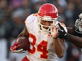 Knile Davis of the Kansas City Chiefs runs against Stacy McGee #92 of the Oakland Raiders at O.co Coliseum on December 15, 2013