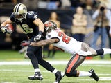 Lance Moore of the New Orleans Saints catches a touchdown pass over Leonard Johnson of the Tampa Bay Buccaneers at Mercedes-Benz Superdome on December 29, 2013