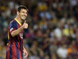 Barcelona forward Lionel Messi gives a thumbs up on September 18, 2013