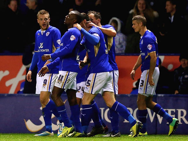 Leicester's Lloyd Dyer celebrates with teammates after scoring his team's fourth goal against Bolton during their Championship match on December 29, 2013