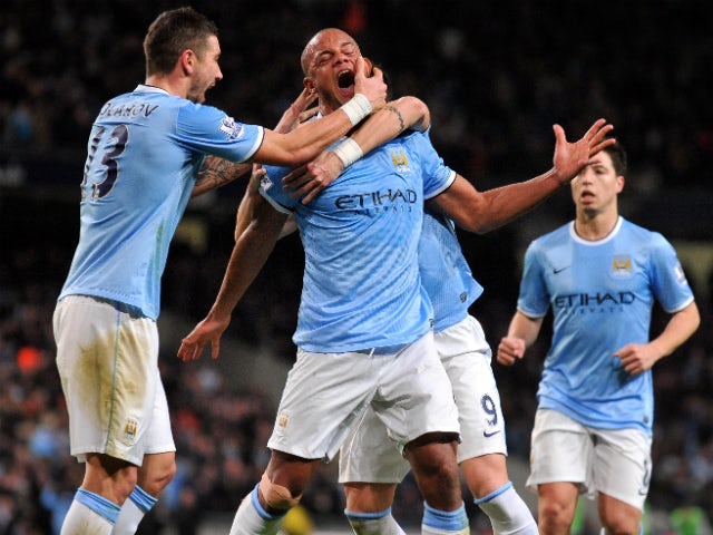 Manchester City's Belgian defender Vincent Kompany celebrates scoring a goal during the English Premier League football match between Manchester City and Liverpool at Etihad Stadium in Manchester, northwest England on December 26, 2013