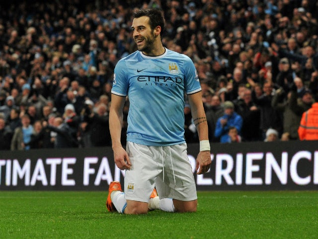 Manchester City's Spanish striker Alvaro Negredo celebrates scoring a goal during the English Premier League football match between Manchester City and Liverpool at Etihad Stadium in Manchester, northwest England on December 26, 2013