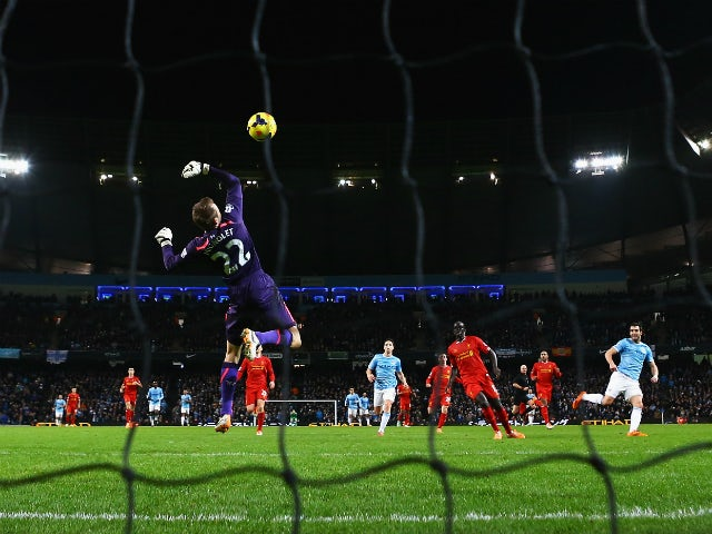 Alvaro Negredo of Manchester City shoots to score past Simon Mignolet of Liverpool during the Barclays Premier League match between Manchester City and Liverpool at Etihad Stadium on December 26, 2013