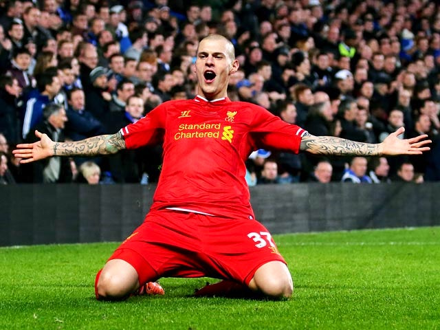 Liverpool's Martin Skrtel celebrates after scoring the opening goal against Chelsea during their Premier League match on December 29, 2013