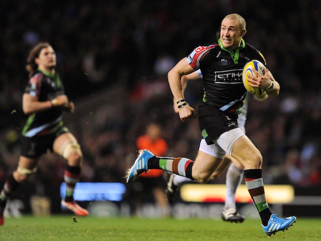 Mike Brown of Harlequins breaks away to score a try during the Aviva Premiership match between Harlequins and Exeter Chiefs at Twickenham Stadium on December 28, 2013