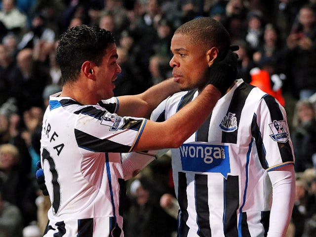 Newcastle United's French striker Loic Remy celebrates scoring their first goal with Newcastle United's French midfielder Hatem Ben Arfa during the English Premier League football match between Newcastle United and Stoke City at at St James' Park in Newca