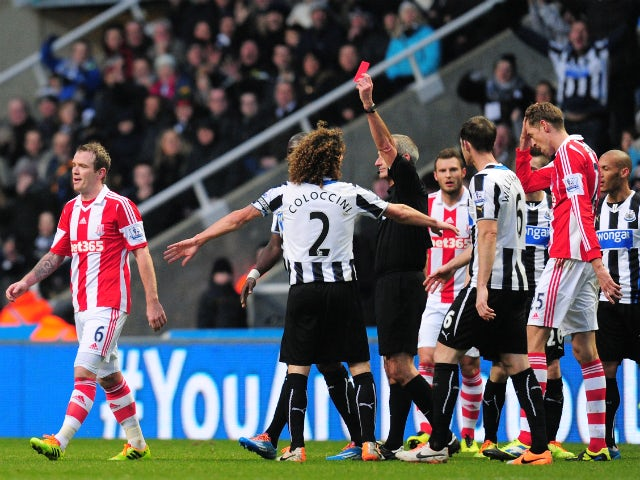 Stoke player Glenn Whelan is sent off by referee Martin Atkinson during the Barclays Premier League match between Newcastle United and Stoke City at St James' Park on December 26, 2013