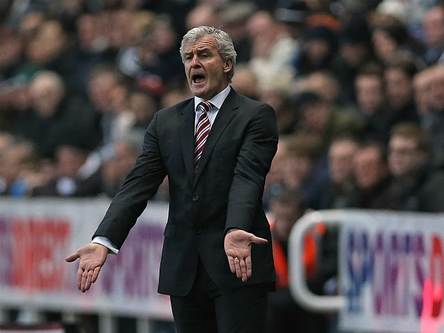 Stoke City's Welsh manager Mark Hughes gestures during the English Premier League football match between Newcastle United and Stoke City at St James' Park in Newcastle-upon-Tyne, northeast England on December 26, 2013