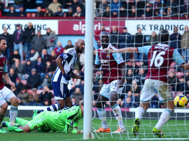 Nicolas Anelka of West Brom scores their second goal past Jussi Jaaskelainen of West Ham during the Barclays Premier League match against West Ham United on December 28, 2013