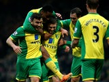 Norwich's Gary Hooper celebrates scoring the first goal of the game with team mates Robert Snodgrass, Leroy Fer and Johan Elmander during the Barclays Premier League match between Norwich City and Fulham at Carrow Road on December 26, 2013