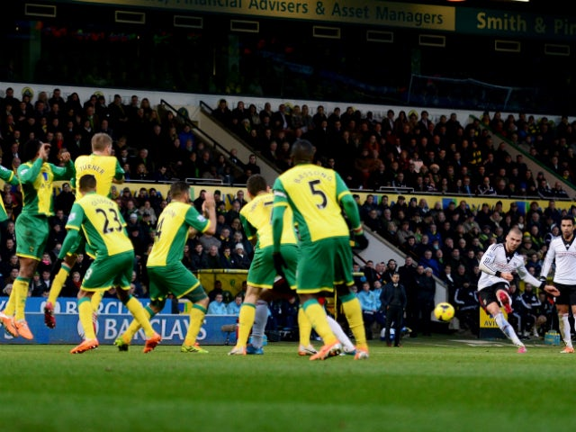 Pajtim Kasami of Fulham shoots from a free kick to score their first goal during the Barclays Premier League match between Norwich City and Fulham at Carrow Road on December 26, 2013