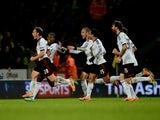 Scott Parker of Fulham celebrates with team mates as he scores their second goal during the Barclays Premier League match between Norwich City and Fulham at Carrow Road on December 26, 2013