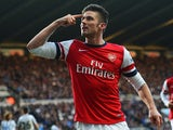 Arsenal's Olivier Giroud celebrates after scoring the opening goal against Newcastle during their Premier League match on December 29, 2013