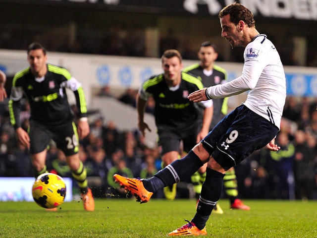Tottenham's Roberto Soldado scores the opening goal via the penalty spot against Stoke during their Premier League match on December 29, 2013