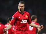 Manchester United's Robin van Persie celebrates scoring against Aston Villa on April 22, 2013.