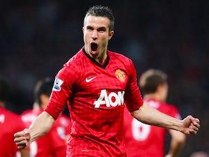 Manchester United's Robin van Persie celebrates scoring against Aston Villa on April 22, 2013.