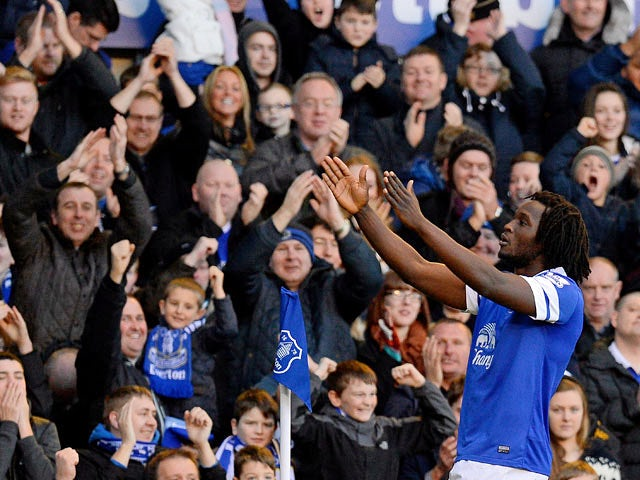 Everton's Romelu Lukaku celebrates in front of fans after scoring his team's second goal against Southampton during their Premier League match on December 29, 2013