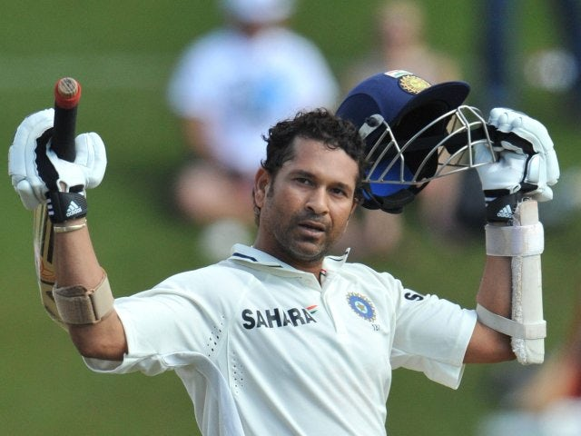 Indian batsman Sachin Tendulkar celebrates scoring a century against South Africa on December 19, 2010.