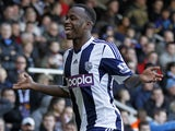 West Bromwich Albion's Burundian striker Saido Berahino cerebrates scoring their third goal during the English Premier League football match against West Ham United on December 28, 2013