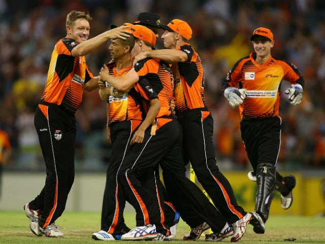 Alfonso Thomas of the Scorchers is congratulated by team mates after winning the Big Bash League match between the Perth Scorchers and the Melbourne Renegades at WACA on December 26, 2013