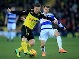 Watford's Sean Murray and QPR's Tom Carroll in action during their Championship match on December 29, 2013