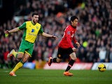 Shinji Kagawa of Manchester United is chased by Robert Snodgrass of Norwich City during the Barclays Premier League match on December 28, 2013