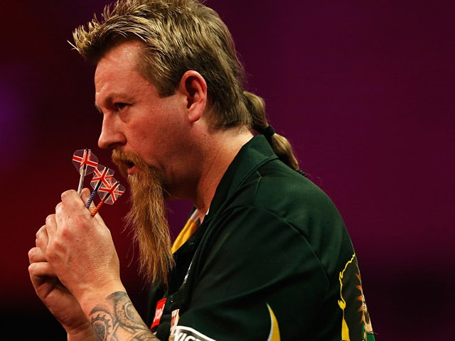 Simon Whitlock in action during the World Darts Championship on December 28, 2013