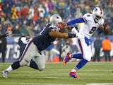 Thad Lewis #9 of the Buffalo Bills fumbles the ball while being ran down by Sealver Siliga #71 of the New England Patriots on December 29, 2013