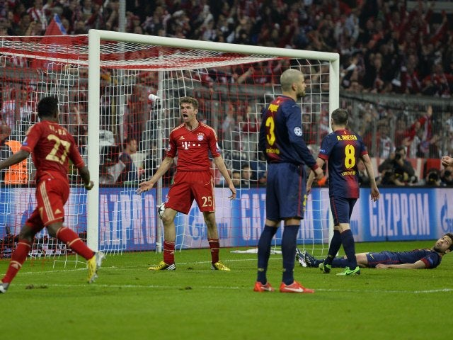 Thomas Muller celebrates scoring against Barcelona on April 23, 2013.