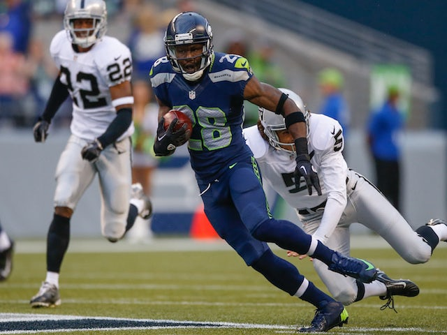 Punt returner Walter Thurmond of the Seattle Seahawks rushes against the Oakland Raiders at CenturyLink Field on August 29, 2013