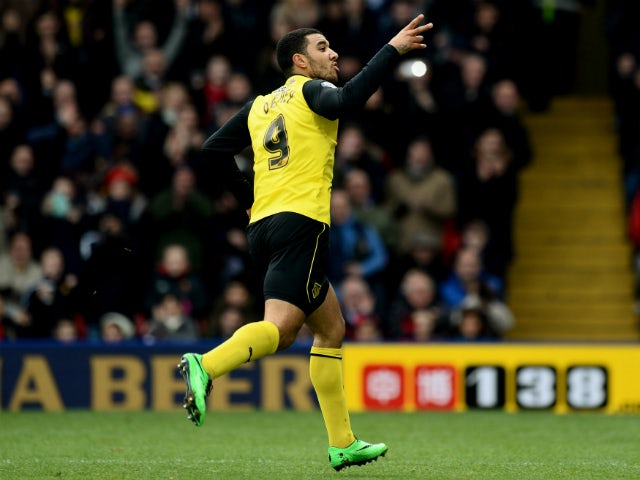 Troy Deeney of Watford celebrates scoring during the Sky Bet Championship match between Watford and Millwall at Vicarage Road on December 26, 2013