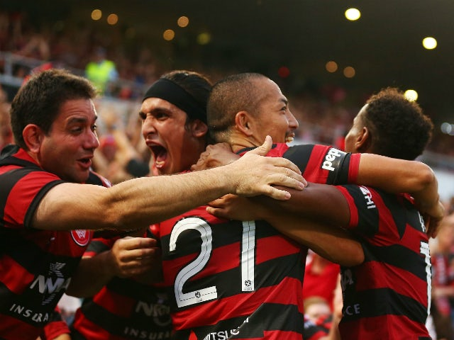 Jerome Polenz, Shinji Ono and Youssouf Hersi of the Wanderers celebrate the second goal to Youssouf Hersi during the round 11 A-League match between the Western Sydney Wanderers and the Central Coast Mariners at Parramatta Stadium on December 23, 2013